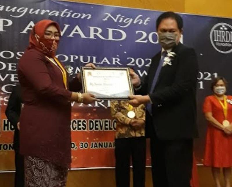 Kadis P3A Bolmong Raih Penghargaan Indonesian Development Award 2021