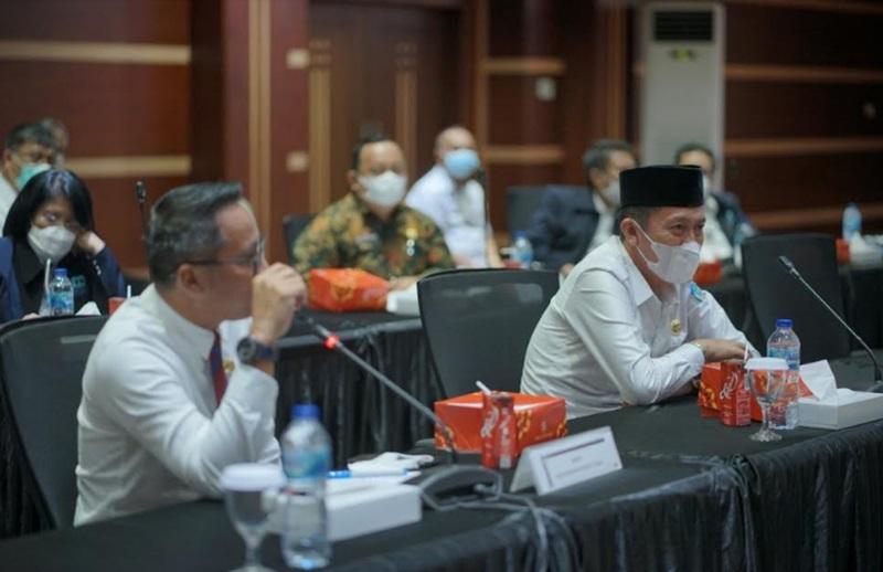 Bupati Bolsel Hadiri High Level Meeting TIPD dan TP2DD Sulut
