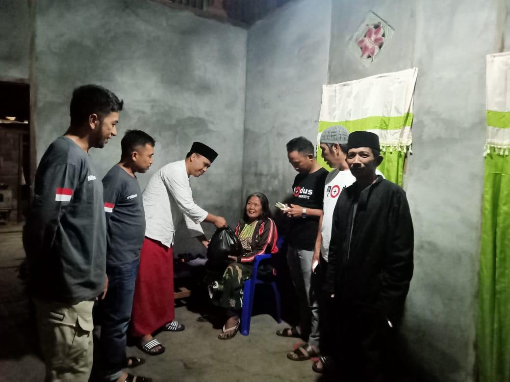 Komunitas Modus Comunity Boltim, Bagikan Sembako Bagi Kaum Duafa di Kecamatan Nuangan